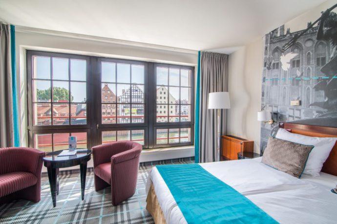 Hotel Hanza med vakre rom og utsikt mot vann